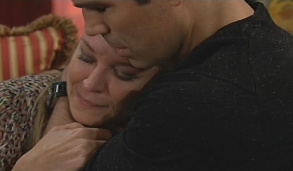 Sharon embraced by Rey Young and Restless
