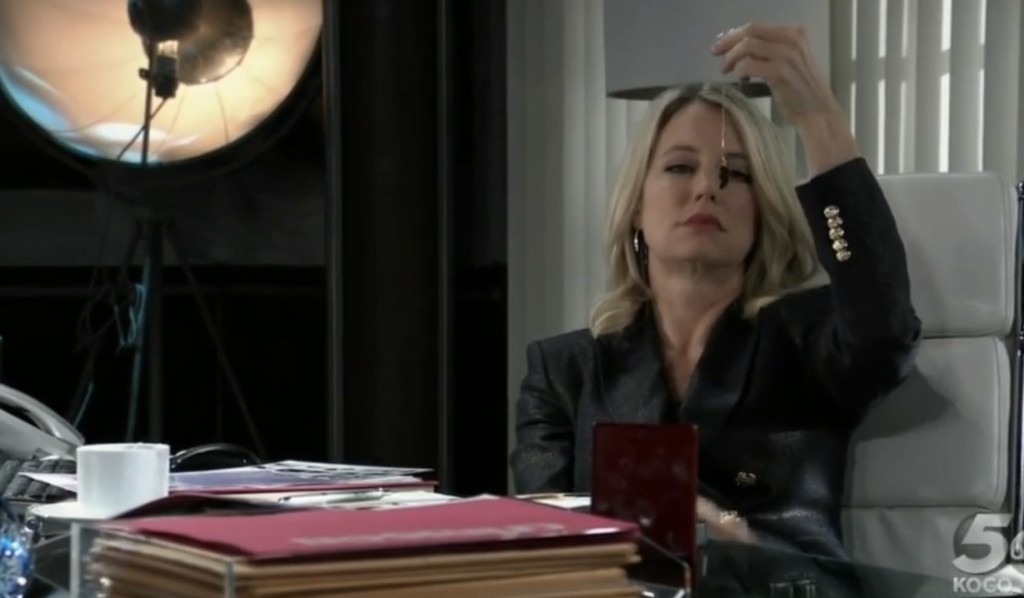 Nina looks at her half heart necklace on General Hospital
