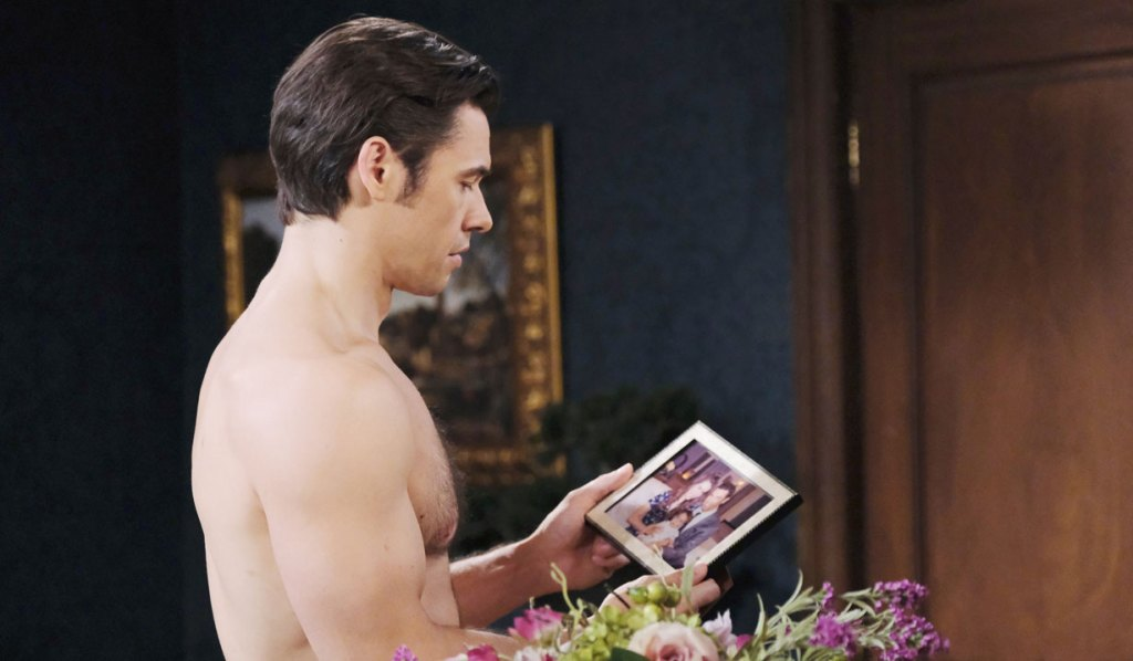 xander looks at a photo of him, sarah and mickey days of our lives