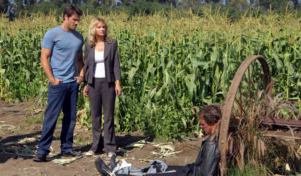 nick saves sahron from cameron in cornfield young and the restless