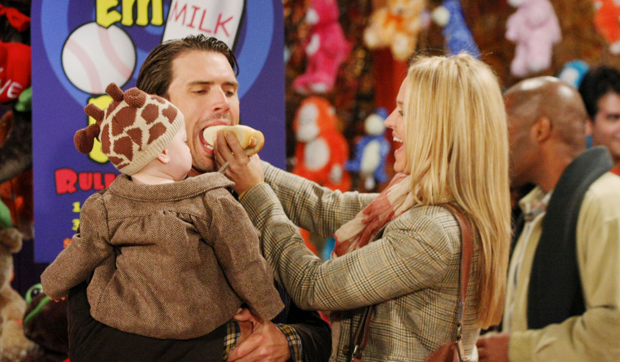 nick, sharon and little noah at the carnival young and the restless