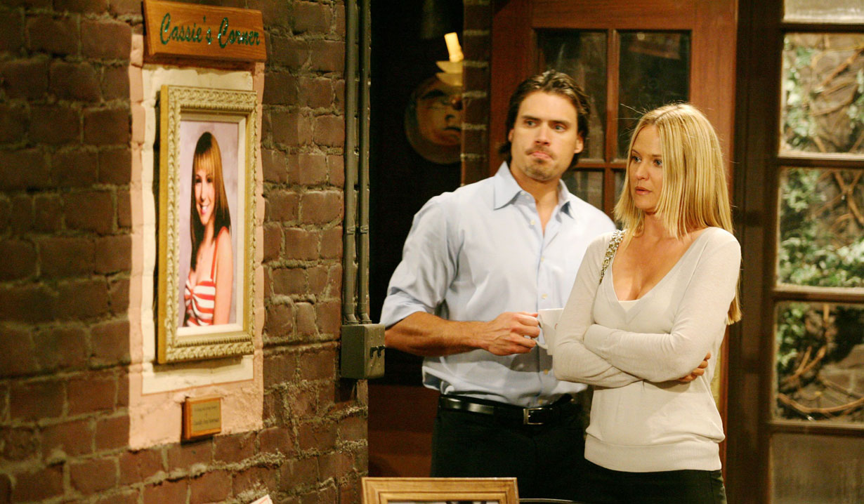 nick and sharon stare at cassie's memorial young and the restless