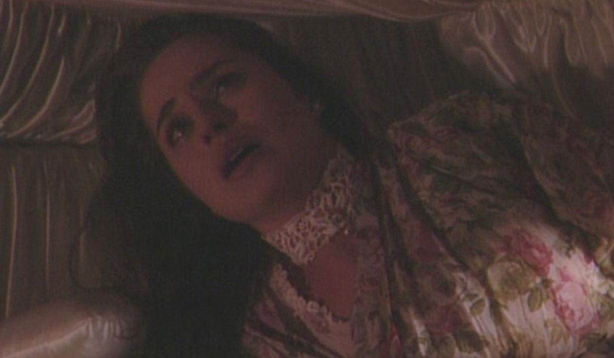 Carly in a casket