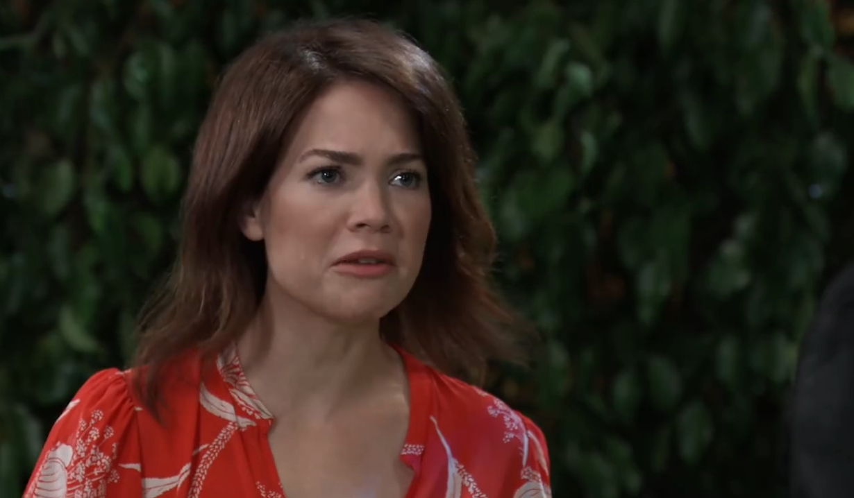 Liz lectures Nikolas about his fake marriage in park General Hospital