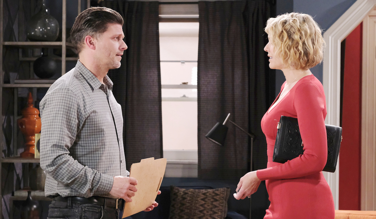 Eric holds a file as he faces Nicole in their apartment