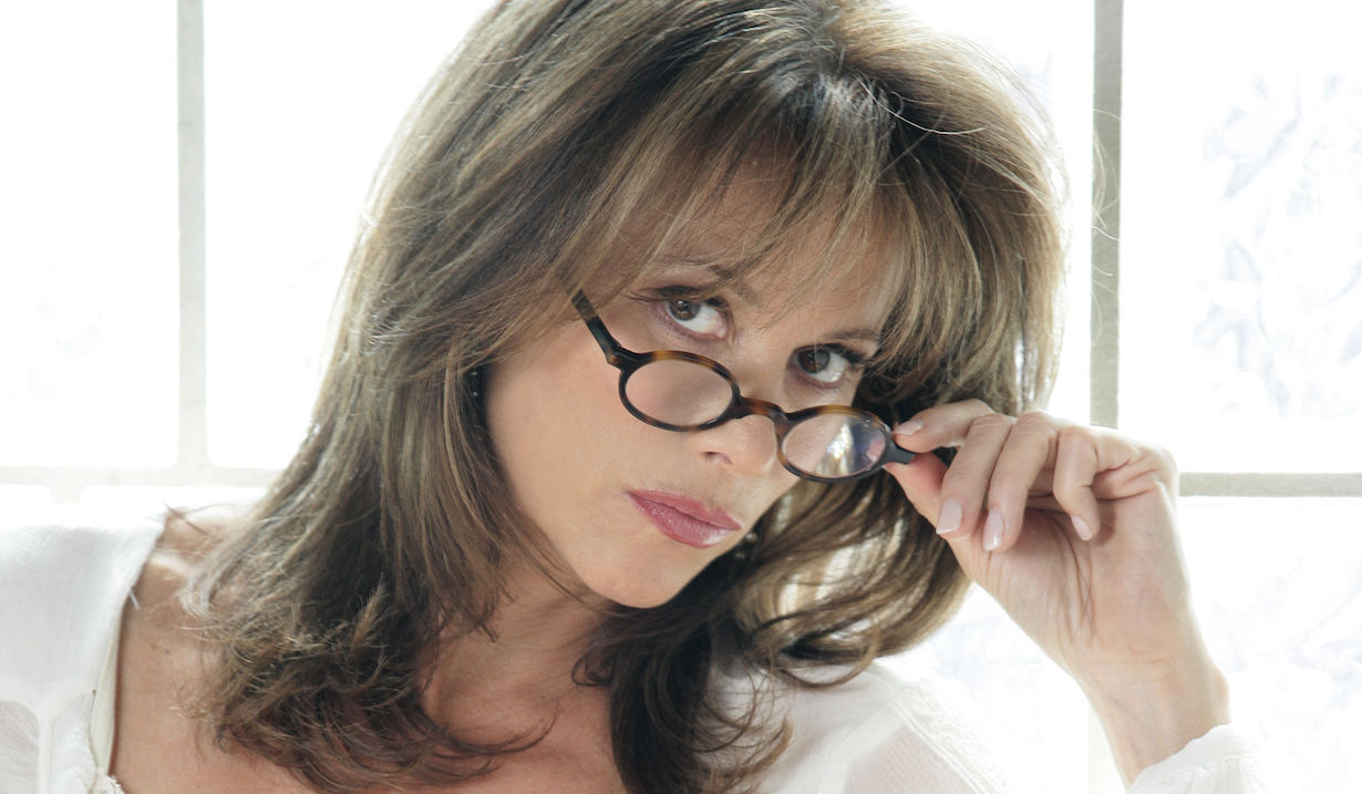 General Hospital Nancy Lee Grahn as Alexis wearing glasses