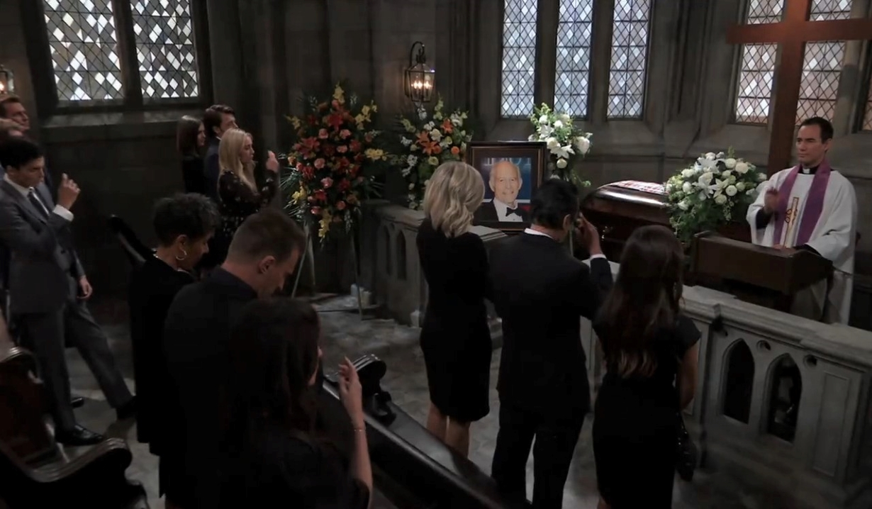 The mourners pray at Mike's funeral General Hospital