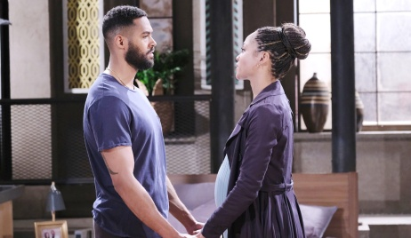 Eli and Lani hold hands while talking at home on Days of Our Lives