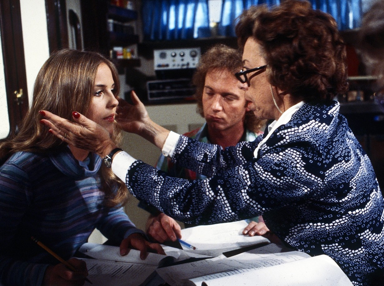 GENERAL HOSPITAL, back, from left: Genie Francis, Anthony Geary, on set, producer Gloria Monty, on set, (1980), 1963- , ph: Curt Gunther/TV Guide/©ABC /Courtesy Everett Collection