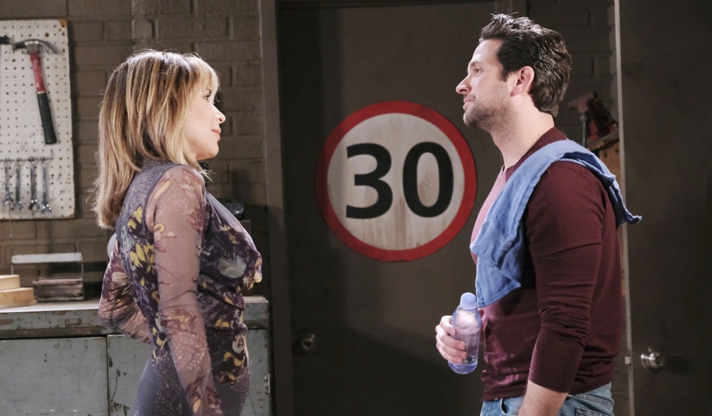 Kate and Jake talk at the garage on Days of Our Lives