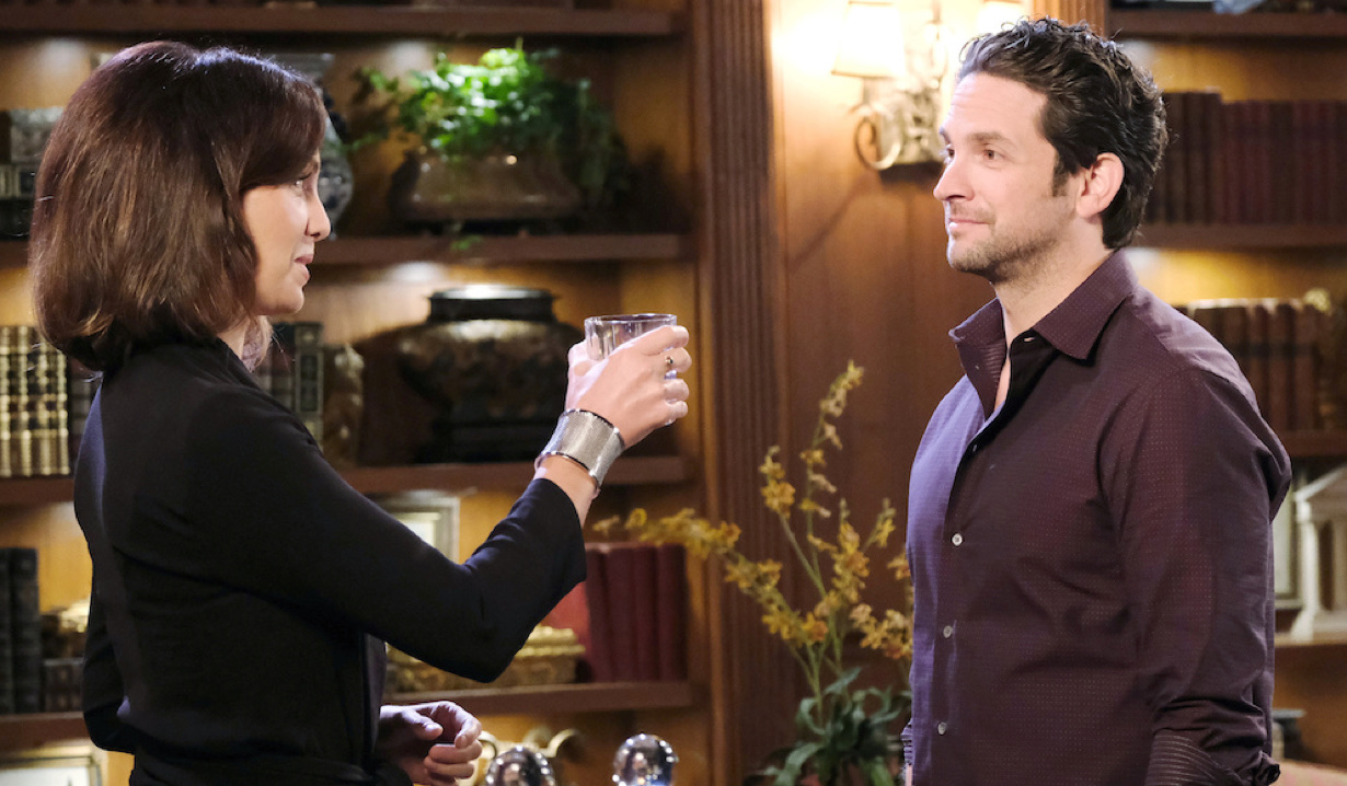 Gwen raises a drink to Jake on Days of Our Lives