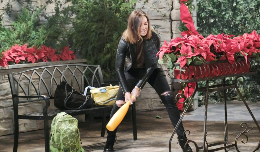 Gwen attacks some flowers in the square Days of Our Lives