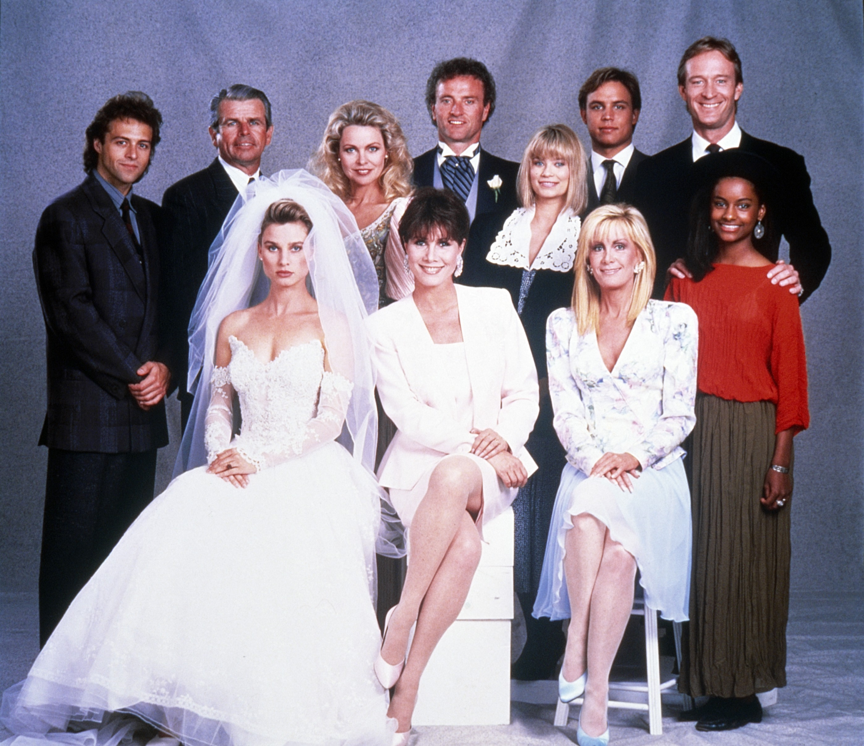 KNOTS LANDING, standing, from left: Joseph Gian, William Devane, Michelle Phillips, Kevin Dobson, Lar Park Lincoln, Pat Petersen, Ted Shackelford, Kent Masters King (red), sitting, from left: Nicollette Sheridan, Michele Lee, Joan Van Ark, 1979-1993. © CBS /Courtesy Everett Collection