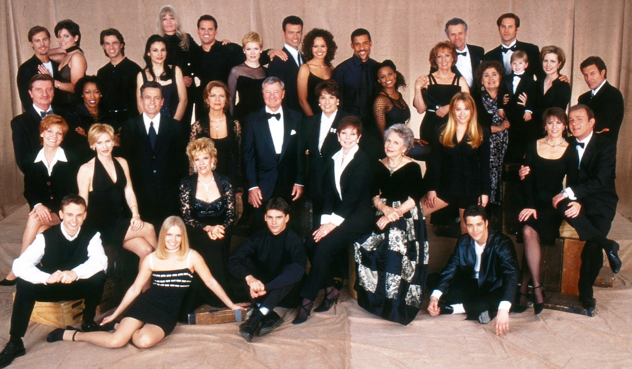 AS THE WORLD TURNS, top row: Scott DeFreitas, Lesli Kay, Keith Coulouris, Annie Parisse, Valerie Perrine, Michael Park, Maura West, John Loprieno, Lauren Martin, Peter Parros, Cassandra Creech, Elizabeth Hubbard, Patrick Tovatt, Jon Hensley, second row, from left: Larry Bryggman, JoAnna Rhinehart, Scott Holmes, Marie Masters, Don Hastings, executive producer Felicia Minei Behr, Jaime Dudney, Kathleen Widdoes, Jeremy Zelig, Martha Byrne, Michael Woods, third row, from left: Ellen Dolan, Kelley Menighan Hensley, Eileen Fulton, Kathryn Hays, Helen Wagner, Colleen Zenk, Benjamin Hendrickson, bottom row, from left: Craig Lawlor, Terri Conn, Ben Jorgensen, Nathaniel Marston, 1999, 1956-2010. ph: Robert Milazzo / © CBS /Courtesy Everett Collection
