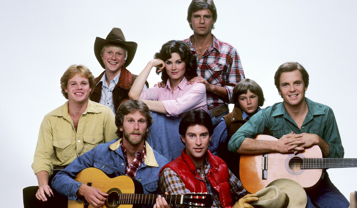 SEVEN BRIDES FOR SEVEN BROTHERS, (back, l to r): Bryan Utman, Terri Treas, Richard Dean Anderson, River Phoenix, (front): Tim Topper, Peter Horton, Drake Hogestyn, Roger Wilson, 1982-83. photo: Robert Phillips / Everett Collection