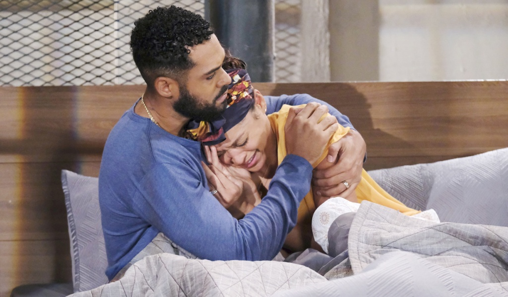 Eli holds Lani in bed as she cries on Days of Our Lives