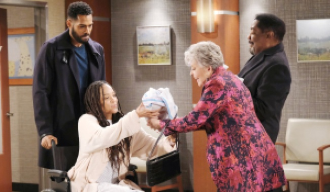Eli and Lani show off their babies to Abe and Julie on Days of Our Lives