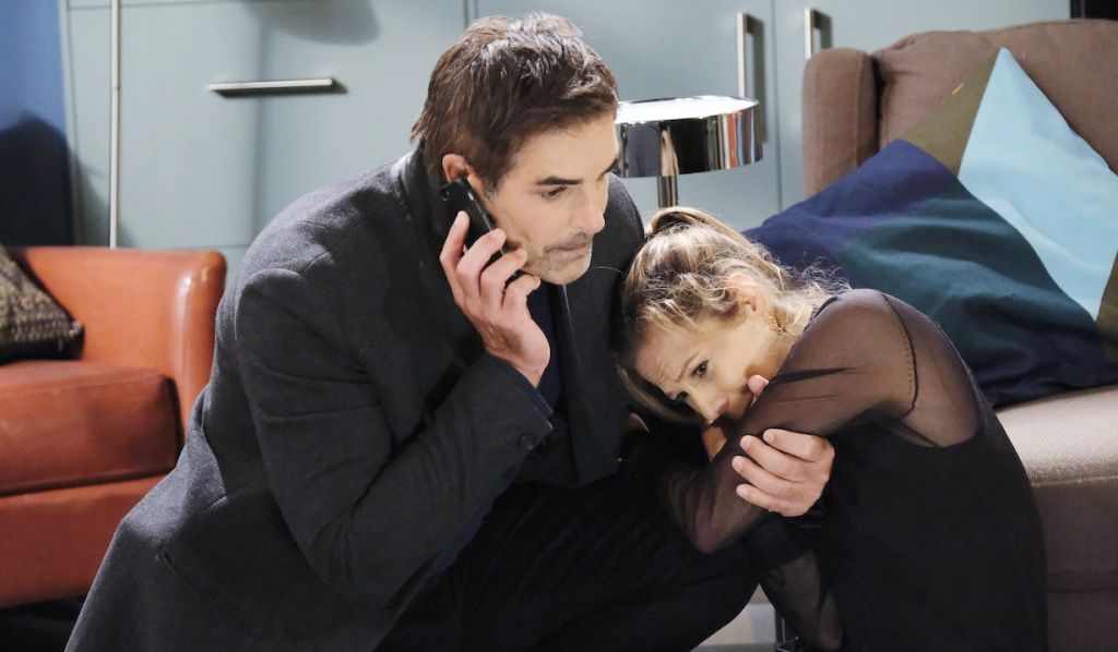 Rafe makes a call as a scared Ava clings to him on Days of Our Lives