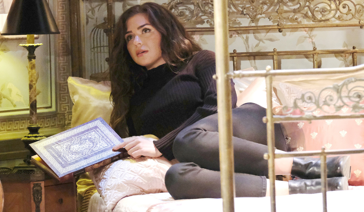 Ciara reads Romeo and Juliet in a glass cage on Days of Our Lives