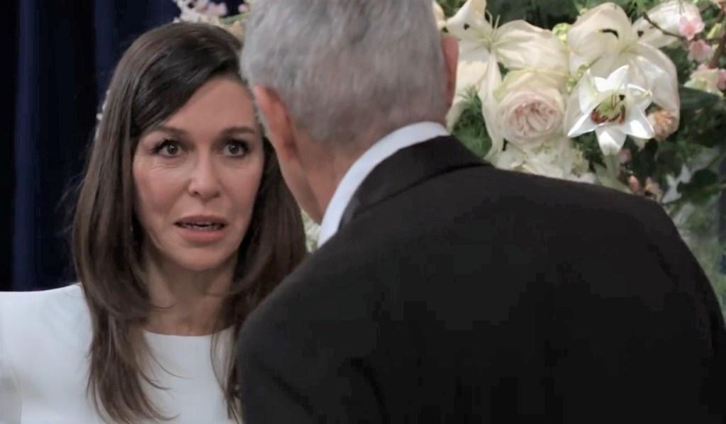 Anna worries to Robert in ballroom General Hospital