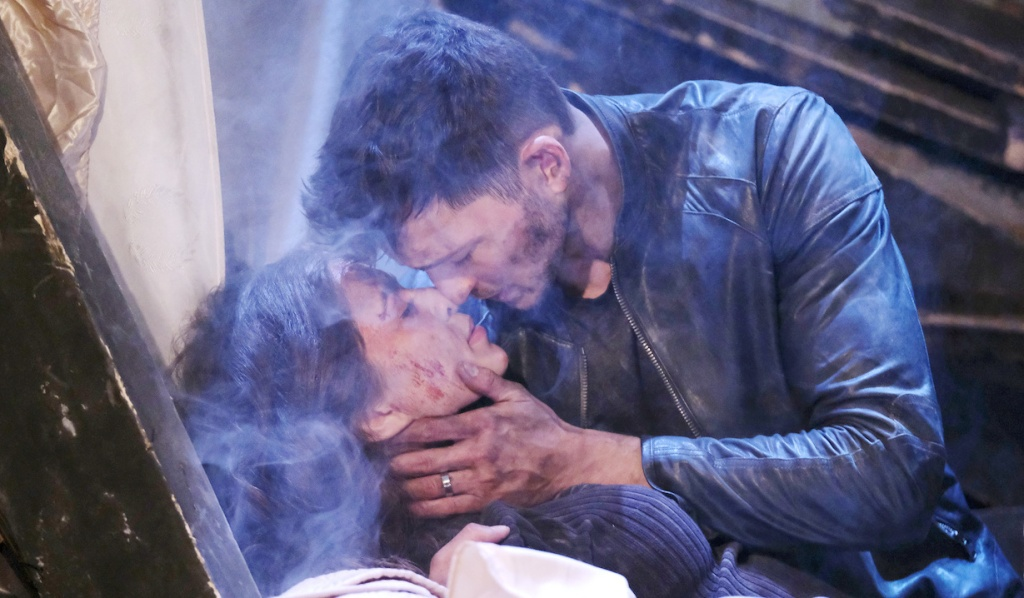 Ben holds Ciara in the rubble on Days of Our Lives