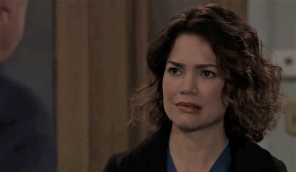 Scott asks Liz if she needs help from family at home General Hospital