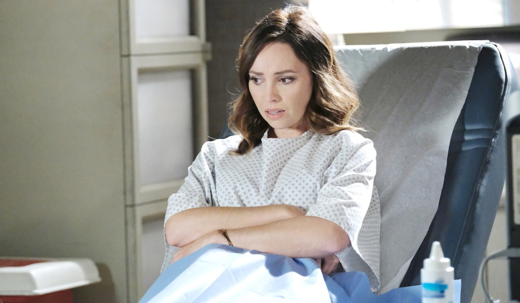 Gwen, arms crossed, in hospital gown on Days of Our Lives