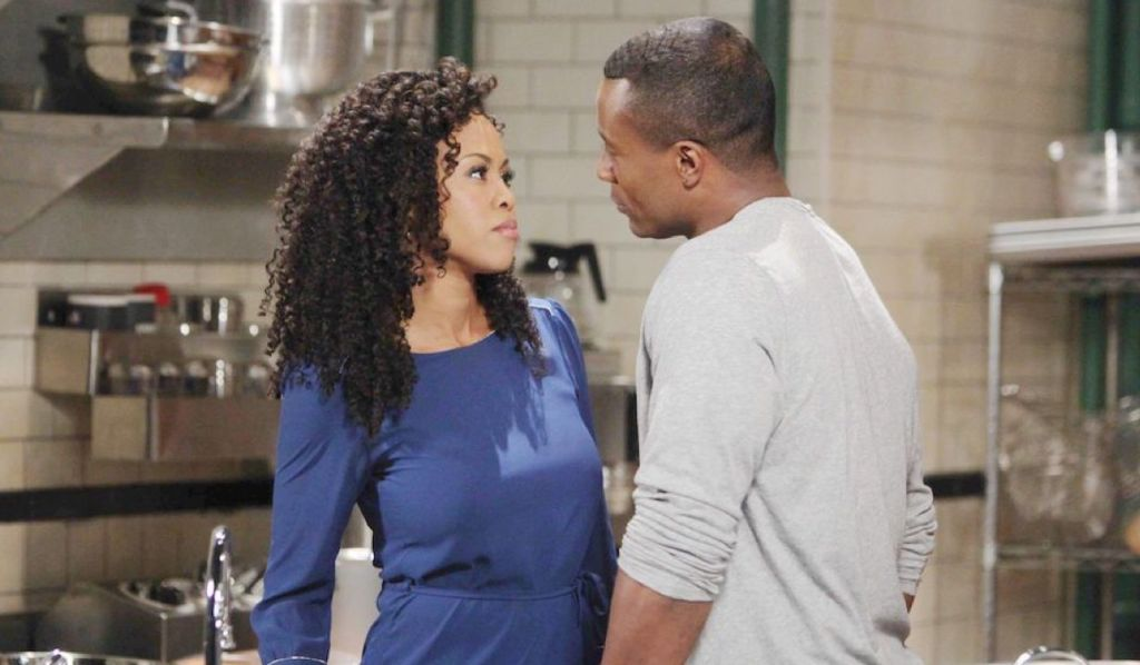 Jordan and Shawn stand close together in a kitchen on General Hospital