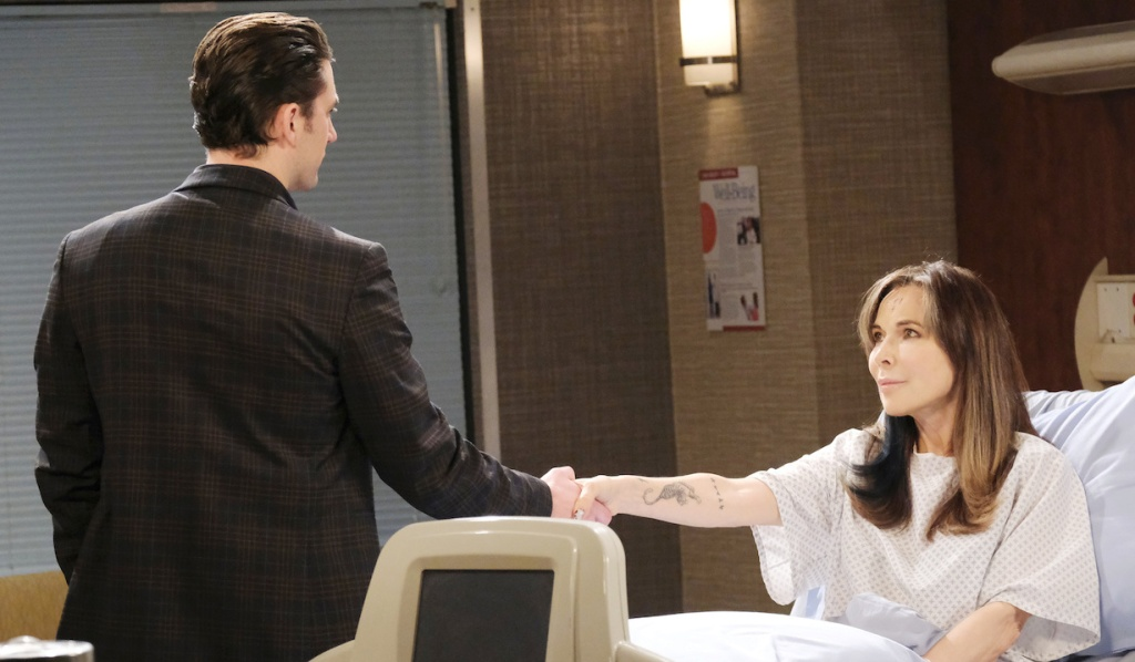 Chad takes Kate's hand as she sits in her hospital bed on Days of Our Lives