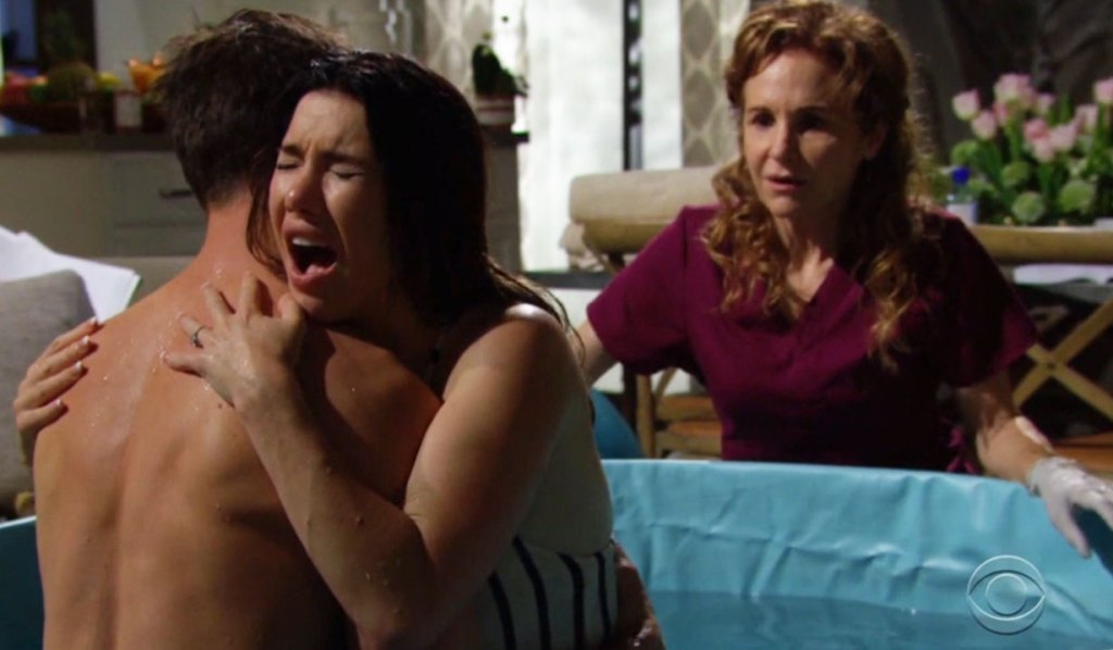finn and steffy in the birthing tub midwife b