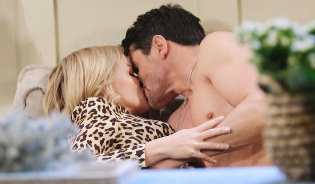 A shirtless Shawn and Belle makeout on the couch on Days of Our Lives