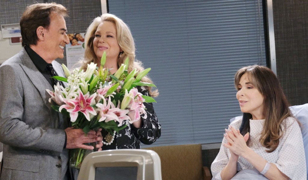 Tony and Anna bring Kate flowers in the hospital on Days of Our Lives