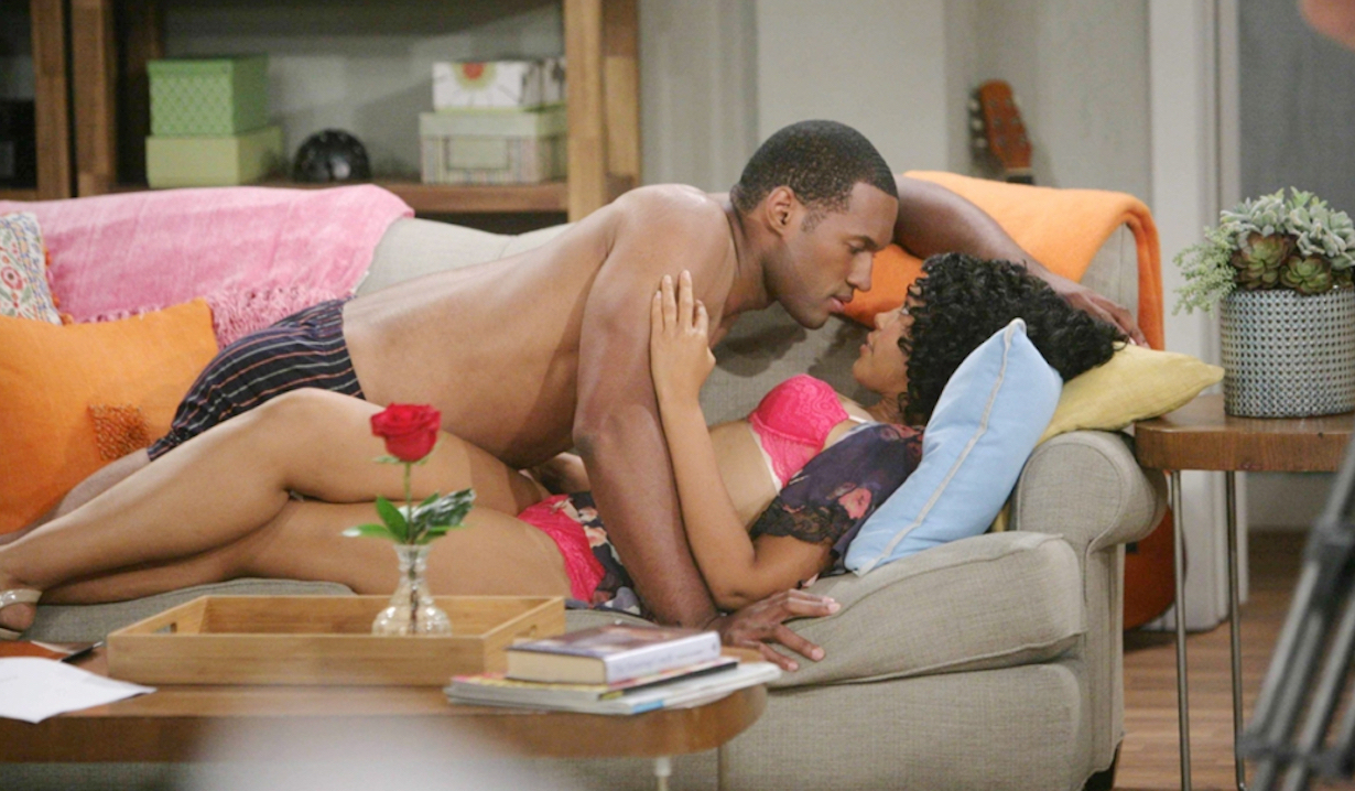Carter Walton and Maya Avant half naked on a couch on Bold and Beautiful