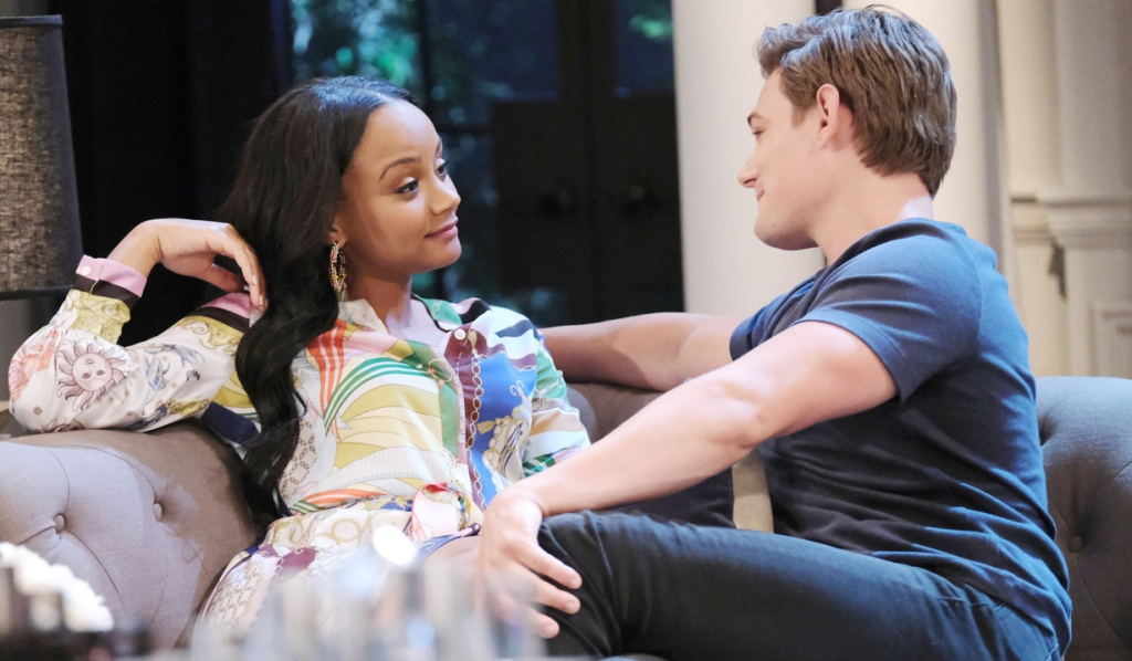 Chanel and Johnny cozy on the DiMera couch on Days of Our Lives