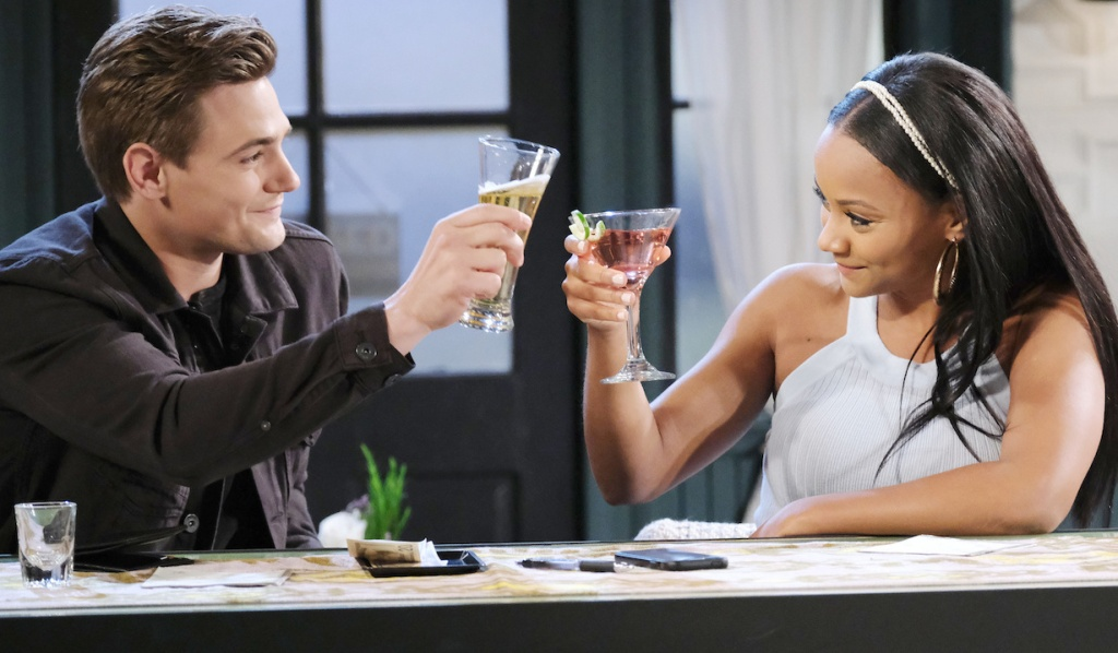 Johnny and Chanel toast at Julie's Place on Days of Our Lives