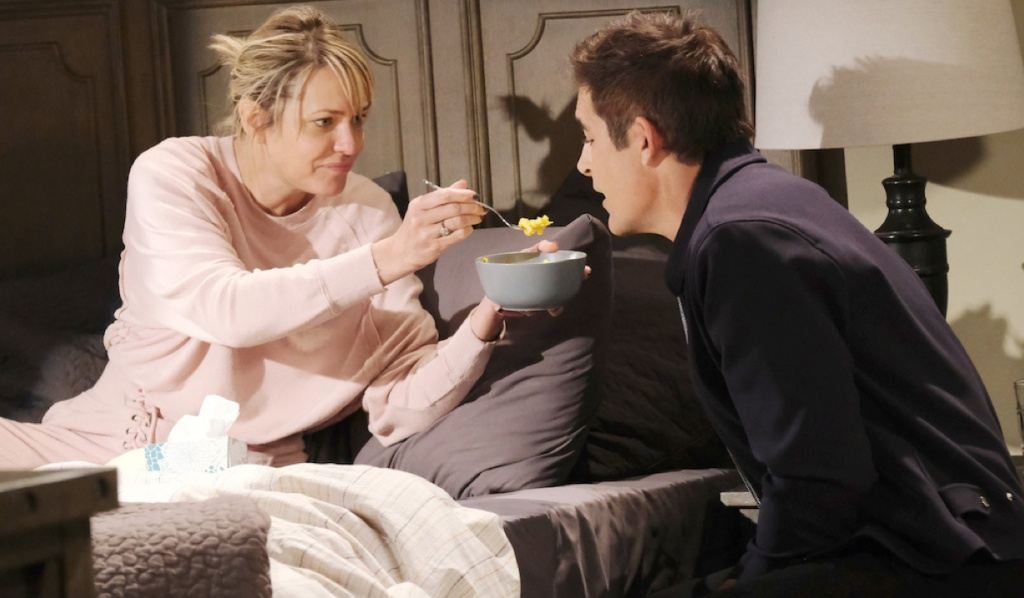 Nicole feeds Rafe in her bedroom on Days of Our Lives