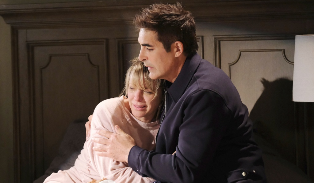 Rafe consoles Nicole in her bedroom on Days of Our Lives