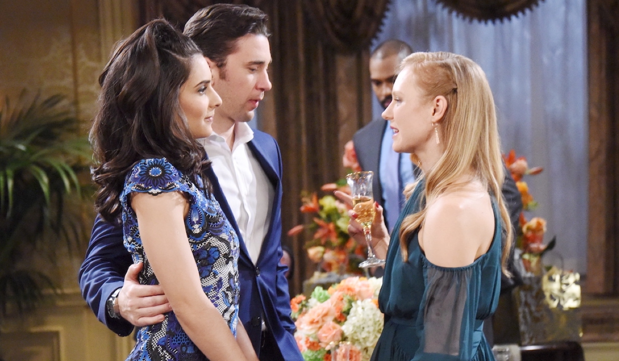 Abby faces Chad with his arm around Gabi on Days of Our Lives