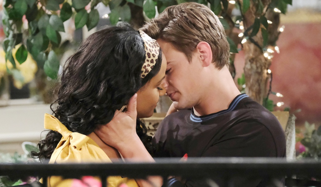 Johnny and Chanel move in for a kiss in Horton Square on Days of Our Lives