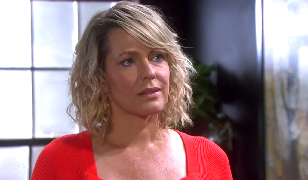 Nicole in a red dress at Titan on Days of Our Lives