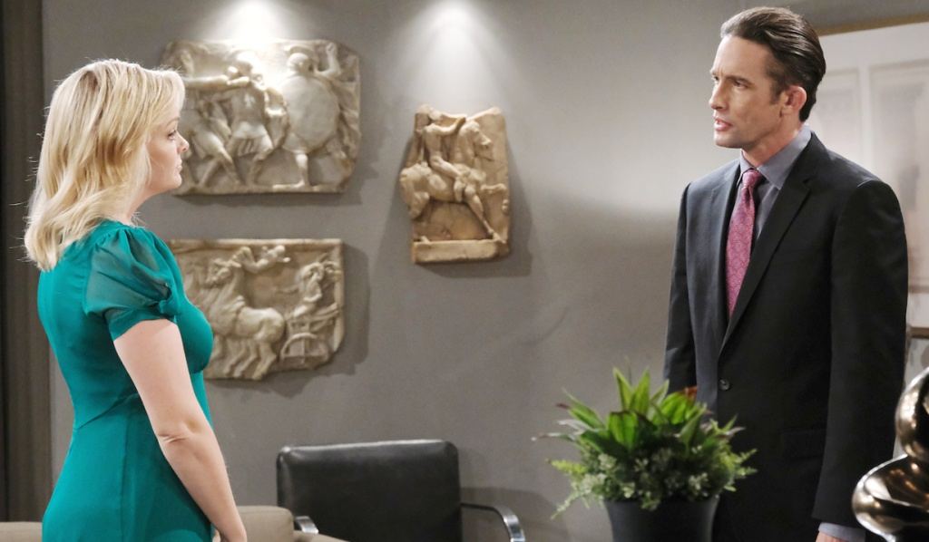 Belle talks to Philip in the Titan offices on Days of Our Lives
