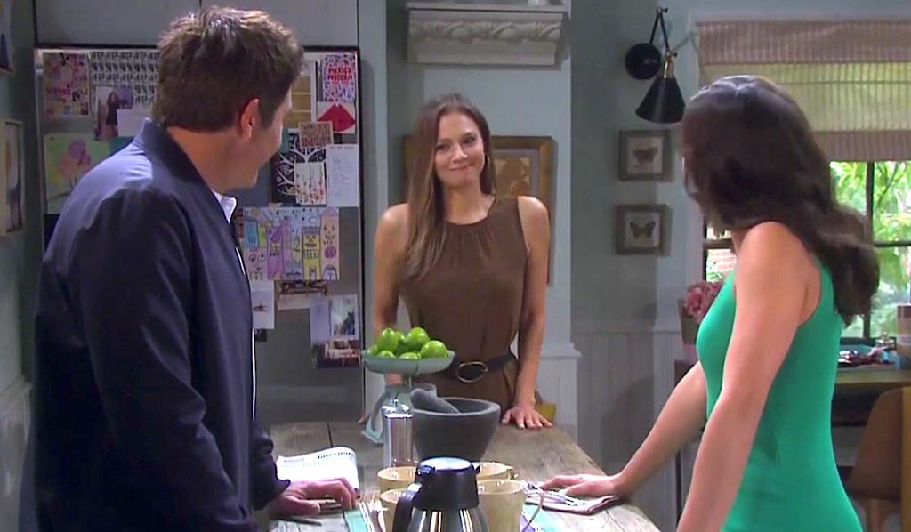 Ava smirks in between Rafe and Gabi in the kitchen on Days of Our Lives