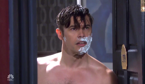 Xander opens his hotel room door with shaving cream on half of his face on Days of Our Lives