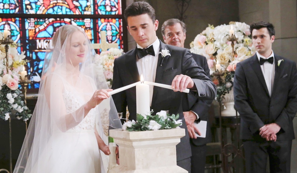 Abigail and Chad light a candle at their wedding on Days of Our Lives