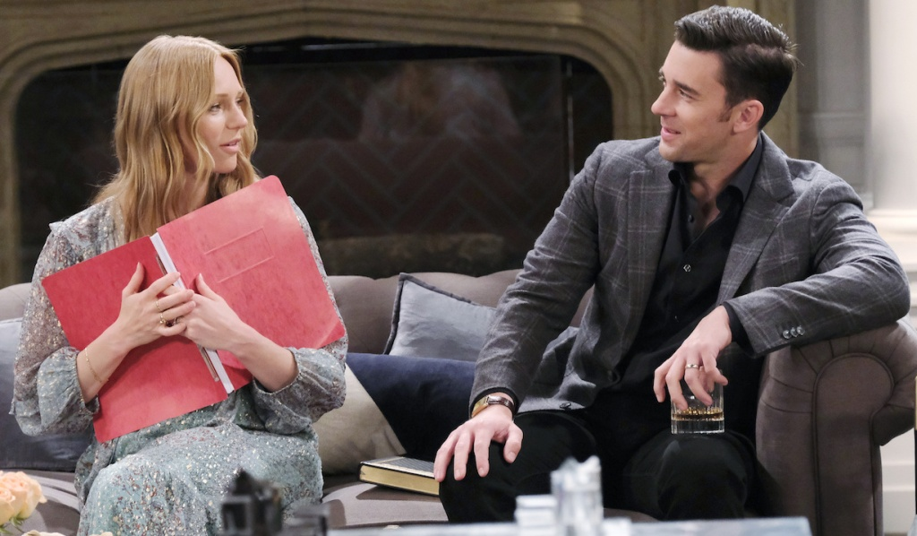 Abby holds Johnny's movie script to her chest as she talks to a smirking Chad at the DiMera mansion