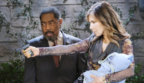 Abe arrives as Kate holds Henry and a gun on Days of Our Lives