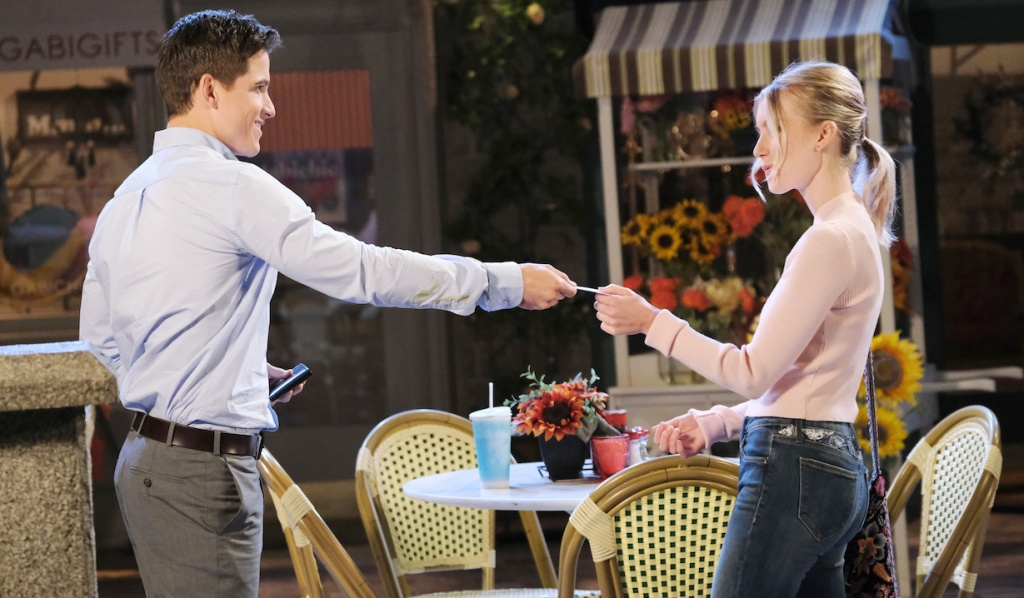 Charlie hands Claire his card on Days of our Lives