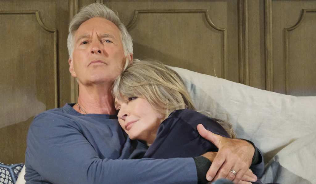 Fully dressed, John holds Marlena in bed on Days of Our Lives