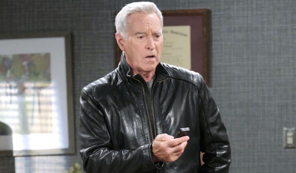 John looks horrified listening to a recording in Doc's office on Days of Our Lives