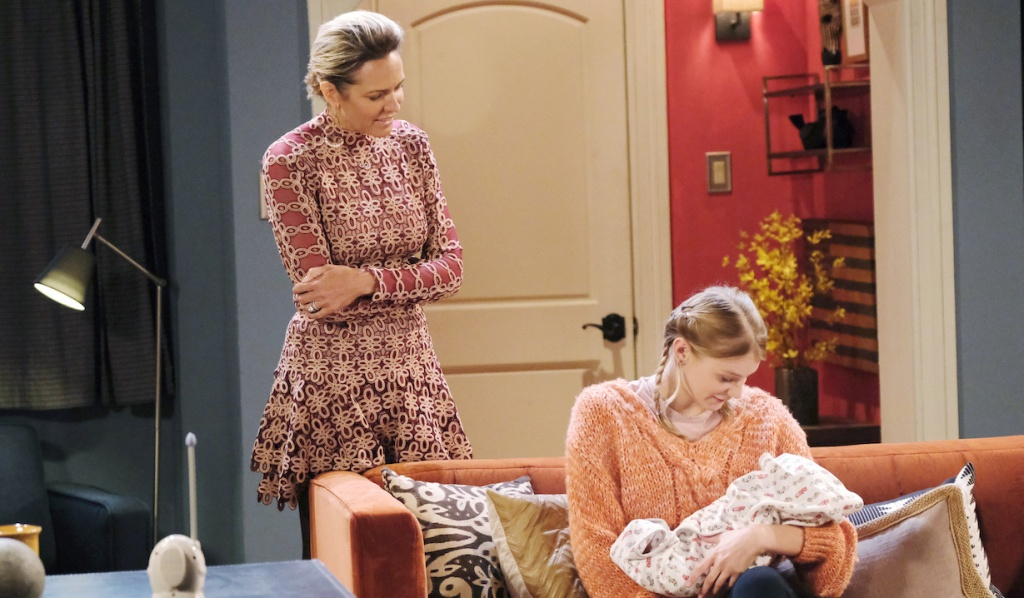 Nicole watches as Allie holds Henry on Days of Our Lives